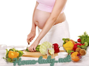 Pregnant woman preparing food in the kitchen